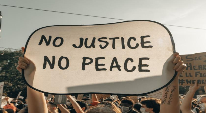 No justice no peace credit clay banks Unsplash