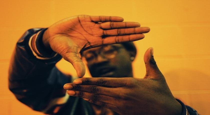 Black man picture hands credit Mikaala Shackelford/Unsplash