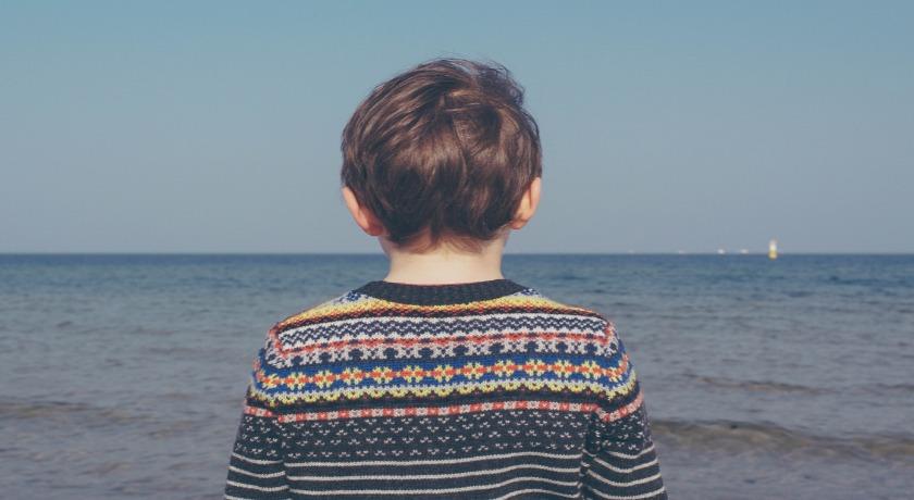 Boy by the sea credit Michal Parzuchow/Unsplash